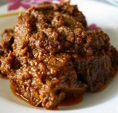 Beef Rendang has a unique flavour, and by varying the amounts of sugar and chilies a whole range of effects can be produced. Serve Beef Rendang over. Spicy Recipes, Meat Recipes, Slow Cooker Recipes, Indian Food Recipes, Asian Recipes, Cooking Recipes, Malaysian Cuisine, Malaysian Food, Think Food