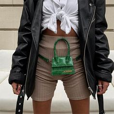 The tiny purse trend was conceived by Jacquemus with his Le Chiquito mini bag. Here are three ways to style his coveted micro bag. Click through for street style inspiration and outfits including how to style a mini bag as a belt or fanny pack. Short Cycliste, Fendi, Jacquemus Bag, Mini Messenger Bag, Weird Fashion, Womens Clothing Stores, Cloth Bags, Mannequins, Cross Body Handbags