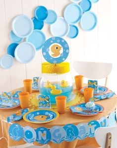 Rubber Ducky Baby Shower Centerpieces | holidays / Rubber Ducky Baby Shower. Plastic plate as decorations ...