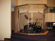 Let's say you like where your drummer is in his corner. But you wish he was more segregated. You need an In Room Drum Room.