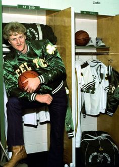 Larry Bird donning a fashion pose in his satin Boston Celtics jacket, dark early jeans, and tan cowboy boots. Celtics Basketball, Basketball Legends, Basketball Players, Pro Basketball, Basketball Pictures, Love And Basketball, Larry Bird, Curry Nba, Celtic Pride