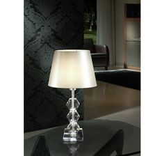 Table lamp made of chromed metal and clear glass.