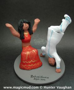 Bhangra Dancer's Wedding Cake Topper by http://www.magicmud.com 1 800 2312 9814    $235 These two are celebrating in a style that is both modern and traditional! The bride is in her lehenga saree and the groom is wearing a kurta...  Any special clothing or garb can be easily incorporated ......#bhangra#lehenga#sari#kutra#indian#india#wedding #cake #toppers  #custom #personalized #Groom #bride #anniversary #birthday#weddingcaketoppers#cake toppers#figurine#gift#wedding cake toppers
