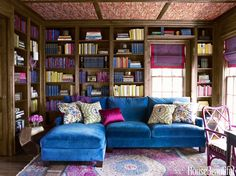 With its lush dose of ultramarine, a custom Lee Industries sectional sofa covered in Fabricut's Renaissance velvet adds vibrancy to a traditional library.
