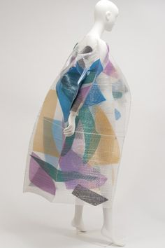 Coat  Issey Miyake, 1994. Layering of different fabrics, levels of sheer