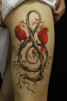 Music tattoo with birds leg tattoo - The front of a thigh is ideal for large and detailed tattoos. This is why many tattoo artists are advised to choose realism for a tattoo on the hip. And if girls would rather choose to tattoo beautiful birds, flowers or colorful butterflies, guys will probably prefer compass, cars or wild animals.