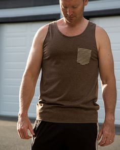 Sewing For Men Free sewing pattern! This modern, simple to sew sleeveless top pattern is a wardrobe staple that can be sewn up as an undershirt or as the ideal summer singlet. Sewing Men, Love Sewing, Sewing Clothes, Men Clothes, Sewing Patterns Free, Sewing Tutorials, Clothing Patterns, Sewing Ideas, Men's Clothing