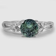 Our nature inspired Willow Diamond Ring set with a 7mm teal round sapphire. #BrilliantEarth