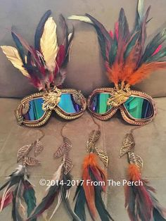 Feather tiara goggles. Yep, you saw it here first. Copyright ©2014-2018 From The Perch This listing is for ONE pair of goggles, the Copper/Rose Gold with Gold/Red/Black feathers. If you would like the Bronze Phoenix Goggles see this listing: