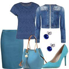 La giacca di jeans con decorazioni metalliche sulle spalle ha un vestibilità aderente. La t-shirt, blu, a maniche corte ha delle decorazioni geometriche mentre la gonna a tubino, turchese, ha l'elastico in vita. La borsa a secchiello, turchese, in finta pelle, ha i manici e la tracolla color cuoio. Le décolleté, turchesi, in similpelle, hanno il tacco di 11 centimetri. Gli orecchini a lobo, infine, hanno il cristallo blu.