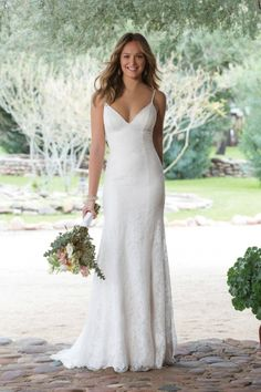 lace wedding dress with spaghetti straps and fitted shape by justin alexander