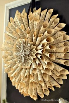 35 Sensible Vintage Like DIY Book Paper Decoration Projects For Your Home. Here a dahlia styled music score wreath