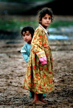 To those looking for some meaningful purpose --- begin by helping others, and you will find it.   (Children in Iraq)