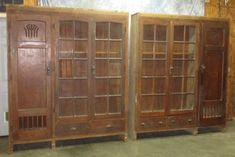 Pair of 2 oak display cabinets that were saved from a demolished school in Quincy, Illinois! Decorative door on the end with pair of glass doors on the other end. 2 small drawers for additional storage. These cabinets measure 85 tall, 72 wide by 22 1/4 deep. Decorative door is 72 x 22