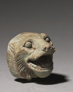 Lion Head, 664-332 BC Egypt, Late Period, Dyansty 26 or later glassy faience, Overall - h:3.00 w:2.80 d:3.00 cm (h:1 1/8 w:1 1/16 d:1 1/8 inches).  Cleveland Museum of Art