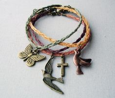 diy bracelet inspiration - Set of Four Bracelets, Braided Antique Gold Charms: swallow, bird, cross and butterfly