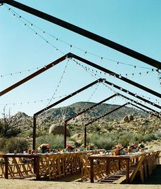 A closer look at the rad reception area from today's Joshua Tree wedding at @theruinvenue - such a dreamy place to dine with your closest family & friends, right?! Tag someone you'd love to dine with under the stars ✨ photog: @_benchristensen   venue: @theruinvenue   florals: @bloombabes   makeup: @novakaplan   paper goods: @joshariza   catering: @sohotaco   desserts: @laurenlowstan   rentals: @otisandpearl @thriftedsisterevents #dineunderthestars #joshuatreewedding #onGWS