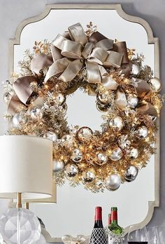 Elegant yet subdued, the Silver Bells Outdoor Cordless Wreath shines with hues of dusty bronze, silver and gold, and details that deserve up-close appreciation. The greenery of this handcrafted accent is cut from textured metallic PVC for added sparkle, and the shatterproof ornaments include a mix of matte and glossy finishes. This stunning arrangement is illuminated by 100 warm-white LED lights.