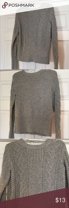 "GAP Designed &a Crafted Cable Knit Crop Sweater Women's Gap Designed and Crafted Brand Crew Neck Cable Knit Crop LS Pullover Sweater  Size:  Medium Color:  Light Gray Material:  40% Cotton, 35% Polyester, 25% Wool Not a heavy weight Chunky Cable Knit, but definitely medium weight yet soft.  Hem is 6"" of stretch as well as 6 1/4"" of stretch at hems of sleeves.  Crop style.      Measurements: Neck to Hem: 22"" Chest lying flat:  17""  (can stretch) Sleeve:  25""  Excellent condition - no rips…"
