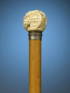 This magnificently carved French ivory cane pays tribute to fine wine. ~ M.S. Rau Antiques