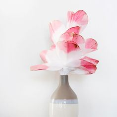 Create these simple tissue paper flowers this spring to add a fresh and fun look to your home decor!