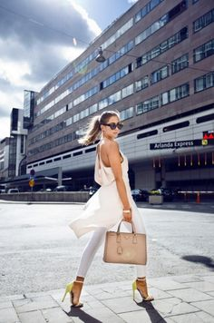 Although this look is still super sexy it is down a day time sexiness with the addition of white skinnies. | 8 Street Style Secrets to Extend the Life of your Party Outfits