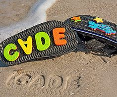 "Leave Your Mark at the Shore: ""Before a trip to the beach, my kids and I hot-glued double layers of foam letters, numbers, and shapes to the bottom of their flip-flops so that theyd leave fun prints when they walked in the sand. Just remember that the prints will be a mirror image, so arrange the letters backward @ Rebecca Britt"