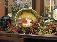 Brass Sleigh and Reindeer from Goodwill! This is in family room on tv cabinet.