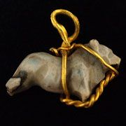 A Rare Middle Assyrian Gold and Agate Bull Pendant (1600 BC - 900 BC)    This pendant is extremely rare. A similar piece was found and published by Maxwell-Hyslop that includes two illustrations from a necklace excavated with a male skeleton. That necklace is now in the British Museum.
