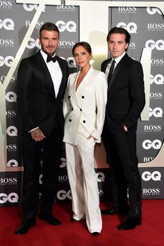 Victoria, David, and Brooklyn hit the red carpet in matching suiting. Victoria Post, Victoria And David, David And Victoria Beckham, David Beckham, Gq Awards, Sexy Librarian, Brooklyn Beckham, Gq Men, Entertainment Tonight