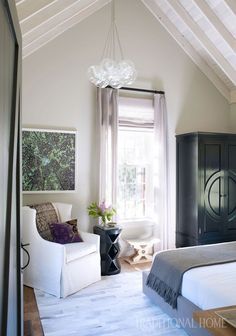 """In the bedroom, exposed rafters and a whitewashed ceiling are balanced with """"weighty Belgian furnishings,"""" designer Terri Ricci says. Bedroom Decor On A Budget, Home Decor Bedroom, Bedroom Color Schemes, Bedroom Colors, Living Room Modern, Living Room Designs, Traditional Lighting, Traditional Interior, Traditional Design"""