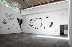 Rita Ponce de León (Lima, Perú, 1982), David (exhibition view), 2013, Ink on wall, video and paper blocks with printed images, Dimensions variable, Courtesy of Sala de Arte Público Siqueiros and the artist, Photo Courtesy: José Jasso