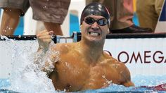 Nathan Adrian of USA celebrates gold in the men's 100m Freestyle