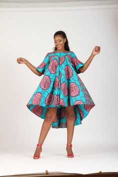 The large flair midi high and low dress made with green and wine ankara fabric. Description: The PBA maxi-flounce midi dress. Color Pattern as seen on model & Available in different colour mix Kindly send email for additional colors. African Fashion Ankara, Latest African Fashion Dresses, African Print Fashion, Short African Dresses, African Print Dresses, Ankara Gown Styles, Latest Ankara Styles, African Attire, African Wear