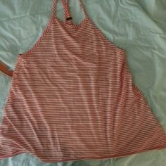 Orange/white stripped racer back tank top by Poof! Size medium racer back tank top by Poof! apparel.   Size medium. Very soft,  and blousey at the bottom.  Cotton/rayon/spandex blend. Poof! Tops Tank Tops