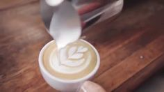 Making Cafe Latte art. I've always wondered how they do this, even though I don't drink coffee. It's soo awesome, and a great tutorial video as well