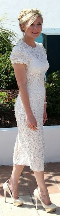 Who made Kirsten Dunst's white short sleeve lace dress and nude with gold platform pumps that she wore in Cannes on May 23, 2012? Dress – Dolce & Gabbana  Shoes – Charlotte Olympia