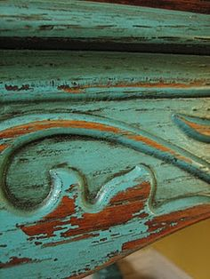 Love the color, the patina of the wood, the swirl of the detailing. Luscious.