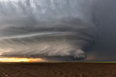 A Kansas Classic: I'm Coming Home Toto! by Roger Hill  Magnificent tornadic supercell thunderstorm in western Kansas on May 21, 2016. This storm spun for hours, spiraling across the countryside with its incredible structure, lightning, huge hail and tornadoes. It was one of those WOW