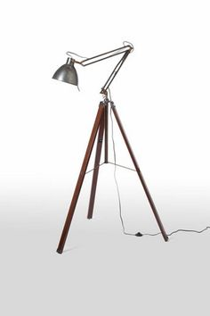 Industrial Tripod Floor Lamp   Barbara Cosgrove. I have one similar made from a camera tripod that I purchased on ebay for about $100. In corner with aviator chair.