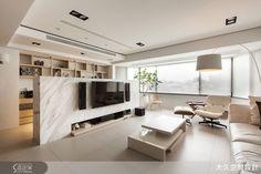 以半高電視牆打造半開放公領域,使整體寬敞富有條理性。