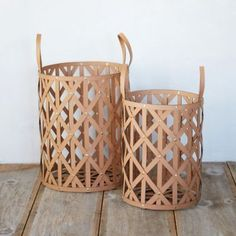 """Designed and crafted exclusively for terrain, this diamond-weave leather basket with grommet details offers a luxurious and practical solution to storage around the house.- A terrain exclusive- Leather, metal grommets- Wipe clean with damp cloth- ImportedSmall: 16.75""""H, 12.25"""" diameter, 5"""" handle dropLarge: 19.75""""H, 15.6"""" diameter, 6.25"""" handle drop"""