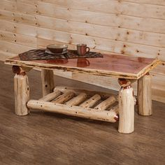 We offer this Wildwood Rustics Red Cedar Log Coffee Table and other fine red cedar log furniture. Browse our rustic furniture catalogs now.  Free Delivery to 48 states.