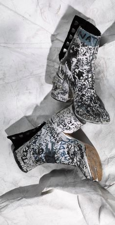 Tabi boots and shoes came in all shapes and sizes, creating a cult loyal following akin to Rick Owen's Geobasket trainers with all the codes and tropes that unite its members. Obviously Margiela didn't create the tabi, but he definitely owns it. Since it first walked down the runway in 1989 Margiela's Tabi design has never been copied. Twenty-eight years later vintage Tabis are hard to find and in high demand. And the more distressed the better. But there's more to Margiela's shoes than the…