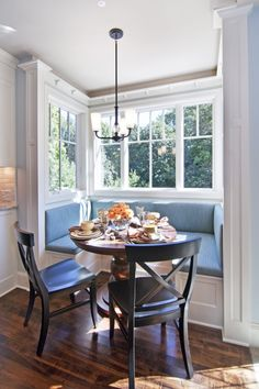 Breakfast nook with round table and 3-sided bench.  Not sure how many people this would fit...