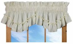 Stephanie Country Ruffle Shaped Valance Curtain - 3 Inch Rod Pocket, Natural by Window Toppers. $24.00. easy care 70% polyester / 30% cotton fabric. elegant ruffled appearance. choice of colors. choice of 1 1/2 inch or 3 inch rod pocket. Made in the USA !. Measures 86 inches wide x 14 inches long and can be ordered with a with choice of 8 solid color fabrics - white, natural, slate, navy, blush, lilac, maize and red. Our Stephanie country ruffle shaped valance window curta...