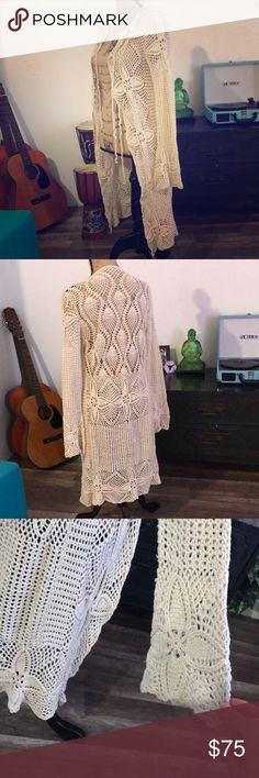 """Gorgeous crochet duster cardigan Size small. Beautiful unique piece. 55% ramie 45% cotton. Has 3 separate ties in front. Adorable belled sleeves. Beautiful intricate work. Shoulder to bottom measures 40"""" long Vintage Sweaters Cardigans"""