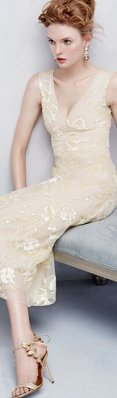 A beautifully cream-colored dress and heeled sandals by Rochas. #Rochas #dress