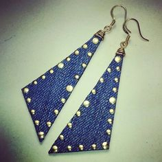 Accessorize in the day and transition into knight with perfection. These Scalene Triangle Denim earrings are edgy and sophisticated. Denim with wire wrapping and ear wires, finished off with nail heads. Everyone will love these earrings!  Total Hang length: 3 ¼ in Total Width: 1 in