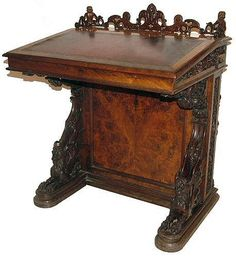 Circa 1851 a Simply Breathtaking Victorian Walnut Carved Davenport Desk by William Gibbs Rogers the eminent 19th Century English woodcarver.